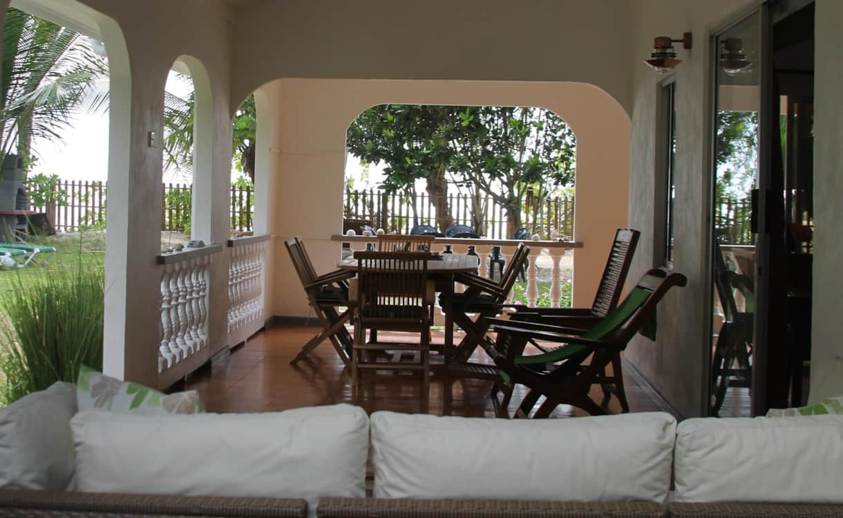 Main Terrace features rattan furniture, lounge chairs and 12 seater teak dining set for 12 people