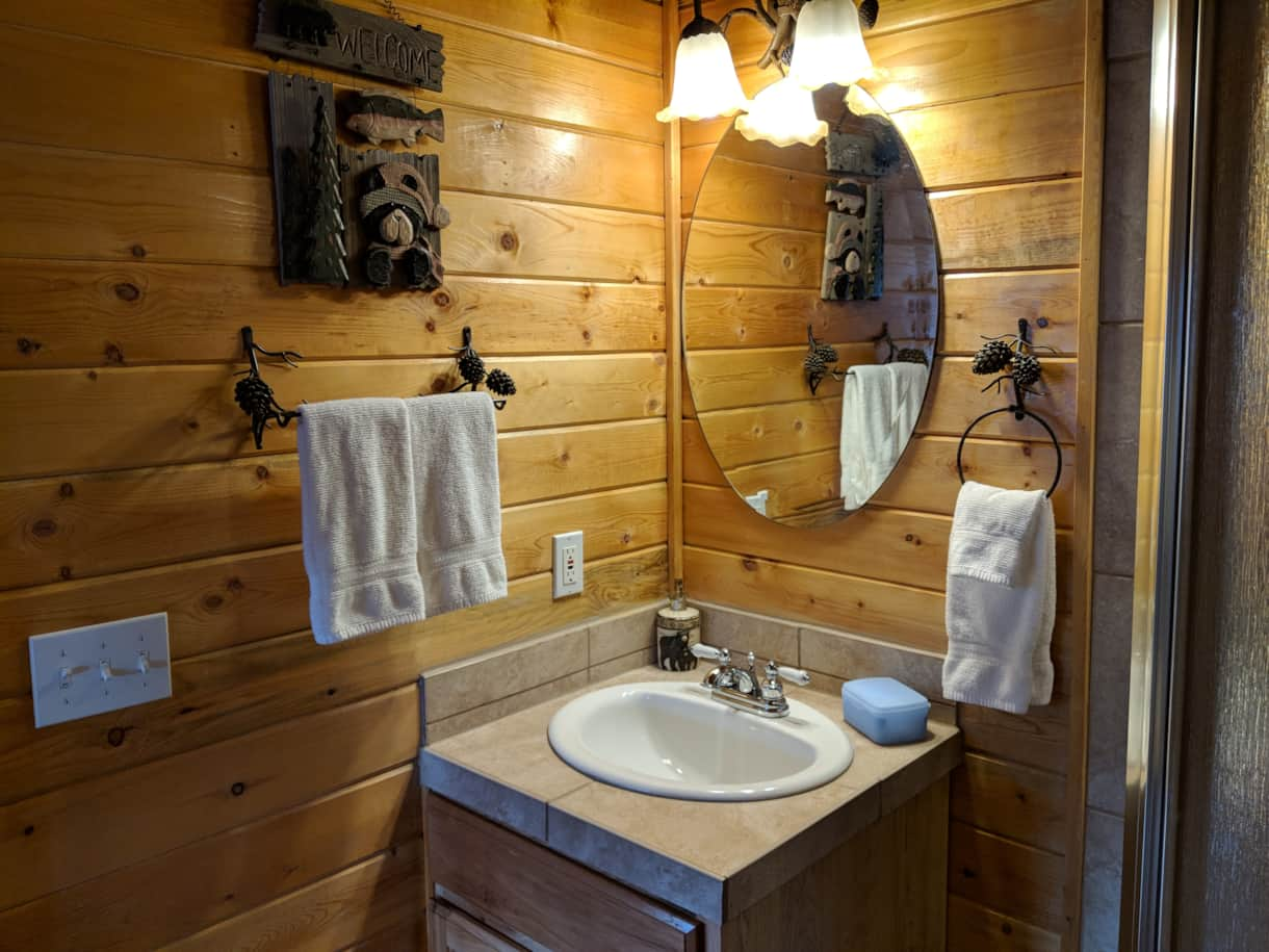 Private bathroom with shower. Shampoo, conditioner, makeup wipes and other amenities provided