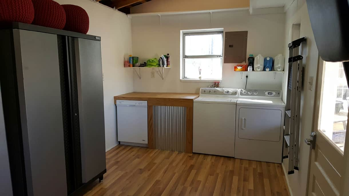 Utility room in shed with washer/dryer and dishwasher