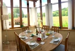 Our conservatory/dining room seats 6-8 people. Enjoys the evening sun