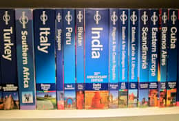 The collection of Lonely Planet guides from our travels