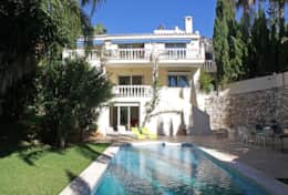 Veiw of rear of villa with pool & gardens