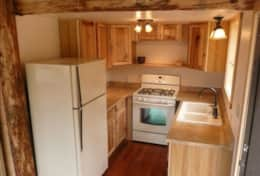 THE KITCHEN IS SMALL BUT IT HAS ALL THE AMENITIES AND DRY GOODS FOR COOKING.