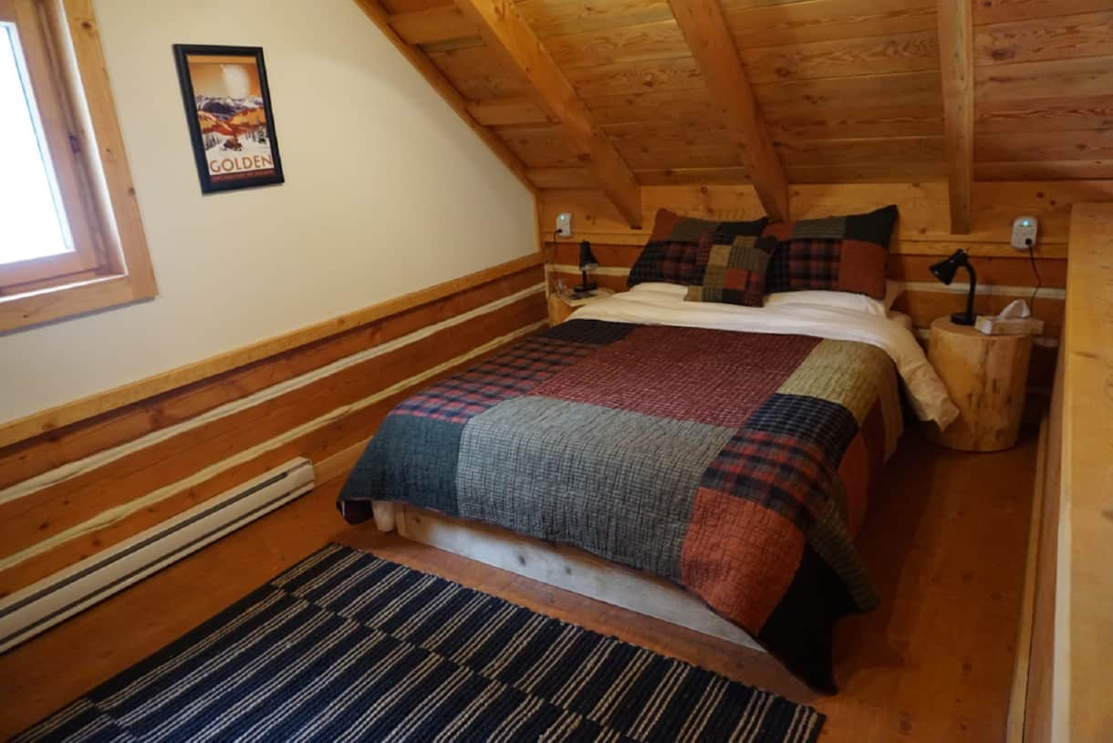 A cozy queen bed in the loft. Mattress by Endy