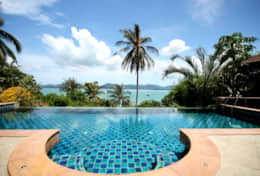 Infinity pool with views across Chalong Bay from living room