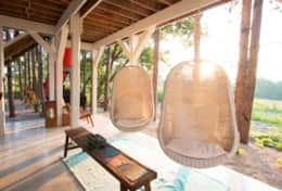 Hammock chairs under treehouse