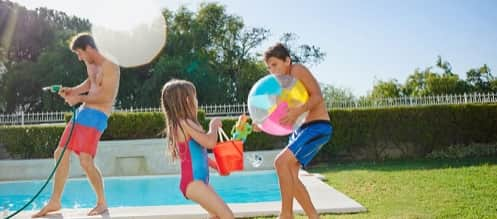 Kids Playing in the Backyard of a Vacation Home Rental