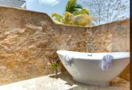 Luxurious outdoor tub in select villas