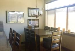 Large dinning room table with extra seating at bar