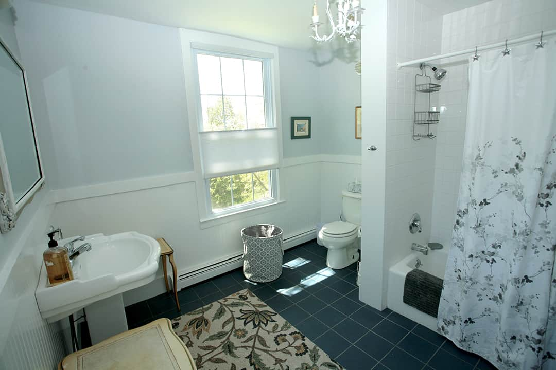 full upstairs bath with tub and shower