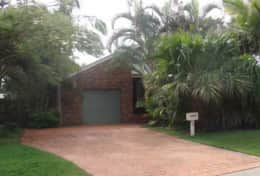 Palms front of house