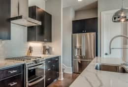 Incredible Modern Kitchen with top of the line appliances, quartz countertops, and Italian Cabinetry