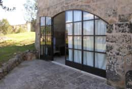 Cava - large glass french door which leads into a double room - Barbarano - Salento