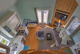 View from the loft of the main cabin floor space. Lofted ceiling is bright and airy.