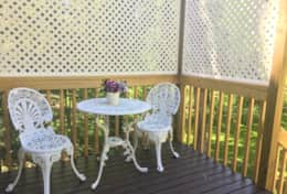 Lovely sitting area to take your morning coffee on the outside deck overlooking the lawn.