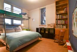 Kids' bedroom with books and bunks
