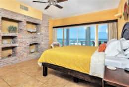 Beautiful ocean view bedroom with ensuite bathroom and terrace access.