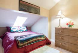 upstairs bedroom with full bed