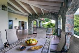 Expansive stone covered veranda with plenty of seating